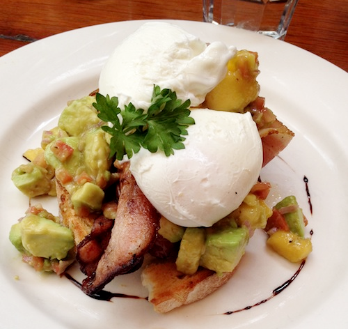 Mango and avocado salsa with poached eggs
